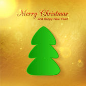 Green paper christmas tree on glimmered golden background — Stock Vector