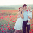 Family in poppy field — Stock Photo