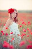 Woman in poppy field — Stock Photo