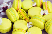 Yellow macaroons on plate, selective focus — Stock Photo