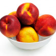 Isolated bowl with nectarine — Stock Photo #39528907