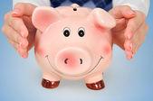 Protect piggy bank — Stock Photo
