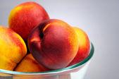 Bowl with nectarine — Stock Photo