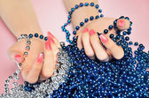 Hand with beads — Stock Photo