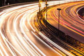 Car lights on highway by night — Stock fotografie
