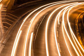 Car lights on highway by night — Stock Photo