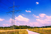 Electrical tower in idyllic landscape — Stock Photo