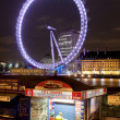 Stock Photo: London Eye by night.