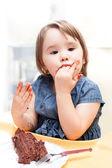 Little girl enjoying her birthday cake. — Stock Photo