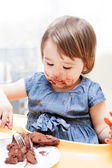 Little girl enjoying her birthday cake. — Stock Photo