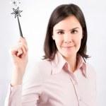 Business woman having a good idea with magic wand. — Stock Photo