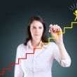 Young businesswoman drawing a career ladder concept. — Stock Photo