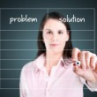 Young business woman writing problem and solution list in blank. — Stock Photo