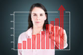 Young business woman writing over achievement bar chart. — Stok fotoğraf
