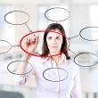Young business  woman writing diagram of centralization. Office background. — Stock Photo #42628539