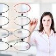 Young business woman drawing blank eight stage strategy flowchart. Office background. — Stock Photo #42628777