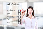 Young business woman checking excellence on customer satisfaction survey form. Office background. — Stock Photo