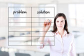 Young business woman writing problem and solution list in blank. Office background. — Stock fotografie