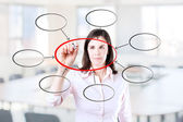 Young business  woman writing diagram of centralization. Office background. — Foto Stock
