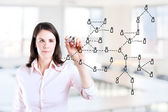 Young business woman drawing Social Network Concept. Office background. — Stock Photo