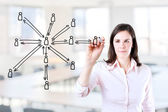 Young business woman drawing social network structure. Office background. — Stock Photo