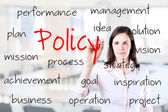 Young business woman writing policy concept. Office background. — Stock Photo