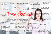 Young business woman writing feedback concept. Office background. — Stock Photo