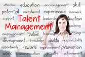Business woman writing talent management concept. Office background. — Stock Photo