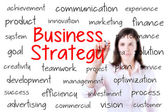 Businesswoman writing business strategy concept. Isolated on white. — Stock Photo