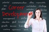 Young business woman writing career development concept — Stock Photo