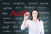 Young business woman writing audit concept — Stock Photo