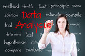 Young business woman writing data analysis concept — Stock Photo