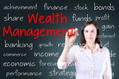 Business woman writing wealth management concept. Blue background. — Stock Photo