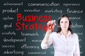 Businesswoman writing business strategy concept. Blue background. — Stock Photo