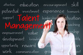 Business woman writing talent management concept. Blue background. — Stock Photo