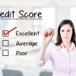 Hand putting check mark with red marker on excellent credit score evaluation form. Office background. — Stock Photo #47037093