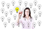 Business woman drawing a great idea concept. — Stock Photo