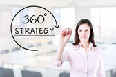 Businesswoman drawing a 360 degrees Strategy concept on the virtual screen. Office background. — Stock Photo
