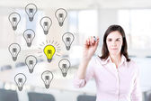 Business woman drawing a great idea concept. Office background. — Stock Photo