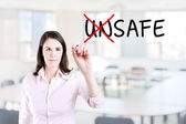 Businesswoman choosing Safe instead of Unsafe. Office background. — Stock Photo