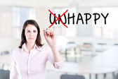 Businesswoman choosing Happy instead of Unhappy. Office background. — Stock Photo