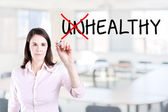 Businesswoman choosing Healthy instead of Unhealthy. Office background. — Stock Photo