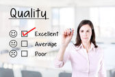 Hand putting check mark with red marker on excellent quality evaluation form. Office background. — Stock Photo