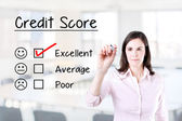 Hand putting check mark with red marker on excellent credit score evaluation form. Office background. — Stock Photo