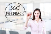 Businesswoman drawing a 360 degrees Feedback concept on the virtual screen. Office background. — Stock Photo