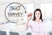 Businesswoman drawing a 360 degrees Survey concept on the virtual screen. Office background. — Stock Photo