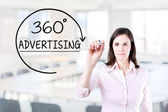 Businesswoman drawing a 360 degrees Advertising concept on the virtual screen. Office background. — Stock Photo