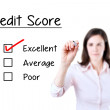 Hand putting check mark with red marker on excellent credit score evaluation form. Isolated on white. — Stock Photo #47043191