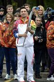Torchbearer of the Olympic flame in 2014 in Russia — Stock Photo