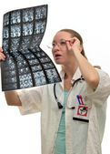 Woman doctor at work is considering an X-ray — Foto de Stock